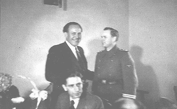Oskar Schindler (center) at his 34th birthday party with local SS officials.  Krakow, Poland, April 28, 1942