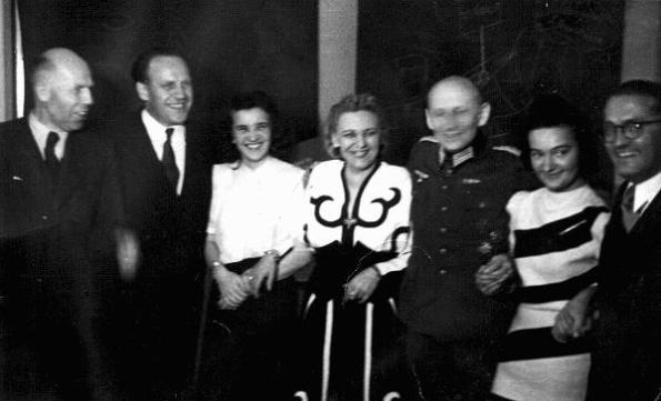 Scene from one of Oskar Schindler's parties in Krakow. At such events, Schindler (second from left) attempted to bribe Nazi officials for information about imminent deportations. Krakow, Poland, 1943